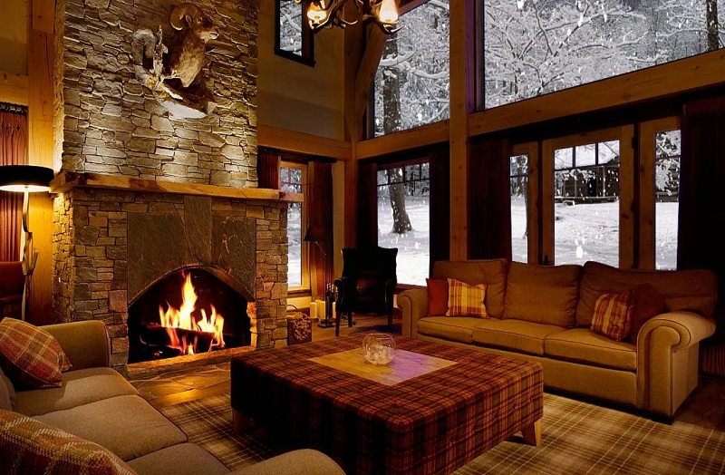 The Hearth Of A Cozy Home - A Fireplace Made Of Natural Stone